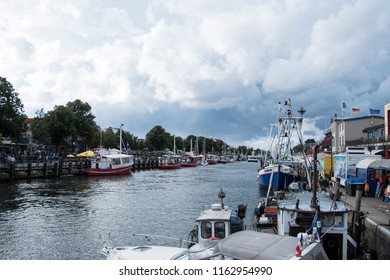 WISMAR GERMANY - AUGUST 20th, 2018: Part of the old harbor in Wismar with fishmonger boats at dock.