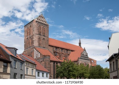 Wismar, Germany, August 20th, 2018: Architecture of ancient gothic St. George Cathedral Church in Wismar
