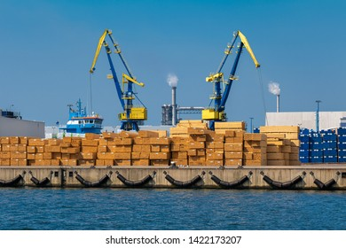 Wismar, Germany. The harbor with pier, cranes and wood.