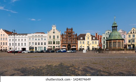 Wismar, Germany - June 5, 2019: The market Square with the Waterworks (German: Wasserkunst) from 1602.