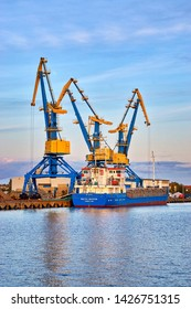 Wismar, Germany - October 07, 2018: Blue and Yellow Industrial Cranes in the Harbor of Wismar. Germany