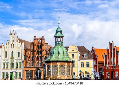 Wismar on the market square with water art and historic facades