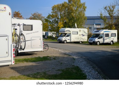 WISMAR/GERMANY - OCTOBER 2018: Caravan parking ground or camping place or Campingplatz with caravans or camping trailers in Wismar, Germany during sunny weather.