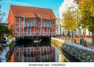 WISMAR/GERMANY - OCTOBER 2018: Historical city center and old houses in Wismar during sunny day during fall