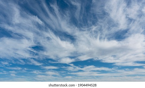 WIspy clouds and blue sky suitable for background