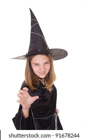 witch in black dress and hat standing