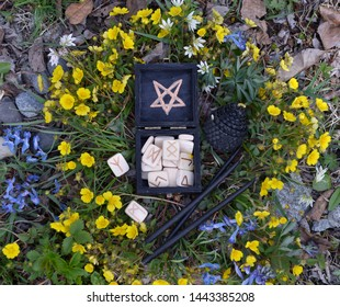 Witch box with white runes and black candles, top view. Wicca, esoteric, divination and occult concept with magic objects for mystic rituals, Halloween, Beltane background