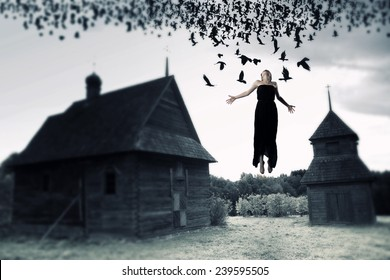 Witch floating in the air. picture in the style of a horror movie.
