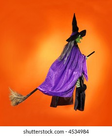 Witch flying on a brrom
