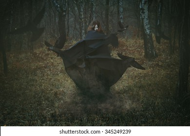 Witch of the forest with her crows . Dark fantasy and magic