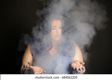 witch girl conjuring smoke with hands