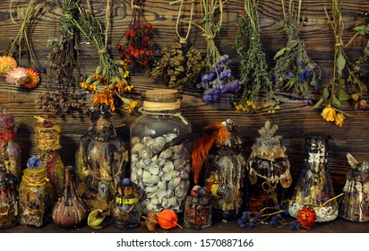 Witch laboratory with potion, elixirs, glass bottles, dry flowers, herbs and ingredients. Esoteric, wicca and occult background, fortune telling and divination ritual, mystic concept