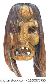 Witch mask carved from wood.
