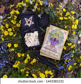 Witch runes, black candles and tarot cards. Wicca, esoteric, divination and occult concept with magic objects for mystic rituals, Halloween, Beltane background
