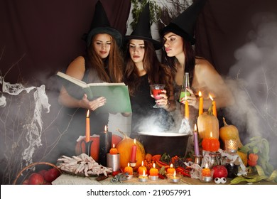 Witches look into the book of magical recipes