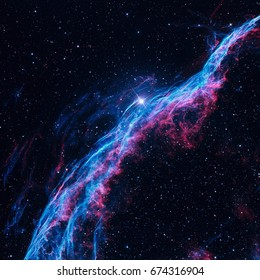 The Witchs Broom Nebula or The Veil Nebula is a cloud of heated and ionized gas and dust in the constellation Cygnus. Retouched colored image. Elements of this image furnished by NASA.