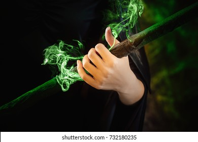 witch's hand holds a magic staff. image for Halloween