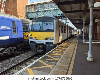 WITHAM, ENGLAND - AUGUST 10 2020: A Greater Anglia class 321 arrives at Witham railway station in Essex with a service for London Liverpool Street.