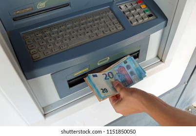 withdrawal of European banknotes in cash from an automatic ATM machine