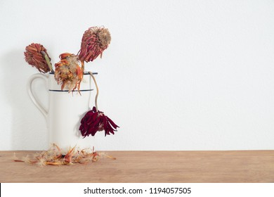 Withered flowers in vase on table with copy space
