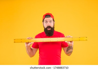 Without geometry life is pointless. Surprised hipster hold ruler yellow background. Geometry lesson. Bearded man use geometrical tool for geometry. Teaching geometry in school.