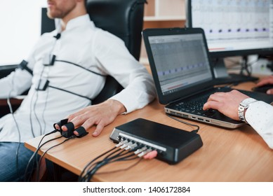 Witnesses said that they saw you at the scene of the crime. Suspicious man passes lie detector in the office. Asking questions. Polygraph test.