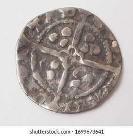 Witney, Oxfordshire, UK 04 08 2020 The reverse of an English hammered silver Farthing coin from the period of Edward I 1279-1351