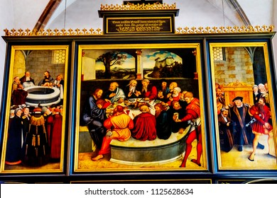 WITTENBERG, GERMANY - MARCH 18, 2018 Saint Mary's City Church Stadtkirche Lutherstadt Wittenberg Germany. Martin Luther's church. Founded in 1187. Last Supper Painting Altarpiece Cranach Elder 1500s