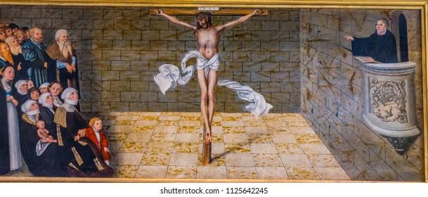 WITTENBERG, GERMANY - MARCH 18, 2018 Martin Luther Christ Altarpiece Saint Mary's City Church Stadtkirche Lutherstadt Wittenberg Germany. Luther's church. Founded in 1187. Cranach Elder 1500s