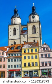 WITTENBERG, GERMANY - MARCH 18, 2018 Colorful Market Square Saint Mary's City Church Stadtkirche Lutherstadt Wittenberg Germany. Martin Luther's church. Founded in 1187, restored in 1900s.