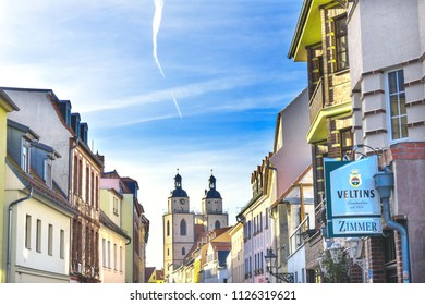 WITTENBERG, GERMANY - MARCH 18, 2018 Colorful Street Restaurant Saint Mary's City Church Stadtkirche Lutherstadt Wittenberg Germany. Martin Luther's church. Founded in 1187, restored in 1900s.