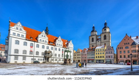 WITTENBERG, GERMANY - MARCH 18, 2018 Martin Luther Statue Colorful Market Square Rathuas City Church Lutherstadt Wittenberg Germany. Statue from 1800s.