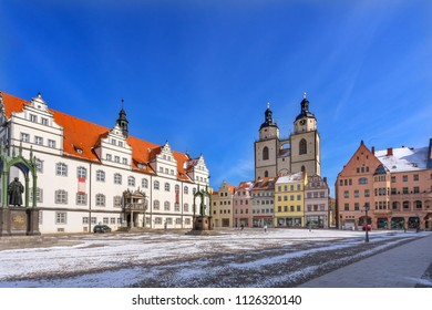 WITTENBERG, GERMANY - MARCH 18, 2018 Martin Luther Statue Colorful Market Square Rathaus City Church Lutherstadt Wittenberg Germany. Statue from 1800s.