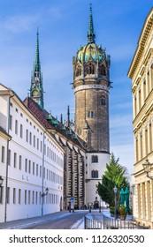 WITTENBERG, GERMANY - MARCH 18, 2018 Shops Restaurants All Saints Castle Castle Church Schlosskirche Lutherstadt Wittenberg Germany. Where Luther posted 95 thesis 1517 starting Protestant Reformation