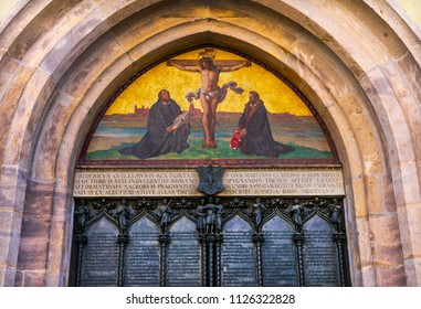 WITTENBERG, GERMANY - MARCH 18, 2018 95 Theses Door Luther Jesus Crucifixion 1858 Mosaic Castle Church Schlosskirche Lutherstadt Wittenberg Germany. 95 thesis 1517 starting Protestant Reformation.