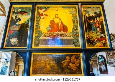 WITTENBERG, GERMANY - MARCH 18, 2018 Cranach Christ Altarpiece Painting Saint Mary's City Church Stadtkirche Lutherstadt Wittenberg Germany. Martin Luther's church. Founded in 1187. 1547
