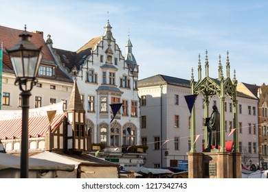 Wittenberg, Germany – October 31, 2018: Market square with Luther statue and historic stalls in the morning