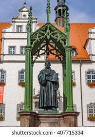 WITTENBERG, GERMANY - SEP 18: The statue of Martin Luther in Lutherstadt Wittenberg, Germany on September 18, 2013. Lutherstadt Wittenberg is a town in Saxony-Anhalt, Germany.