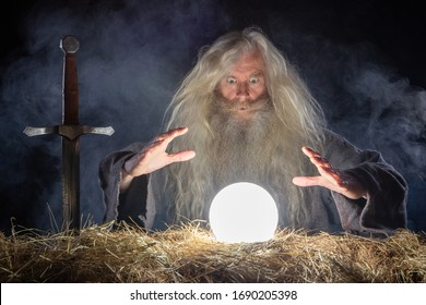 Wizard looking in crystal ball to predict future