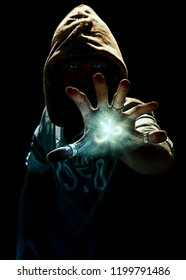 Wizard making spell with six finger's hand, photo manipulation