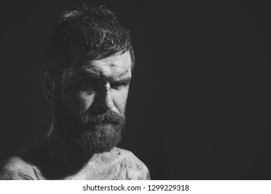 Wizard, sorcerer, warlock. Hipster with beard, mustache on serious dirty face. Bearded man with tattoo on chest skin. Magic, enchantment, witchcraft. Halloween, holidays celebration, copy space