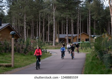 Woburn, Bedfordshire/UK - March 23 2019: Cyclists make their way down a hill in the traffic free Woburn Center Parc