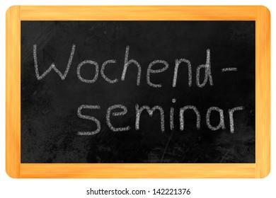 Wochenendseminar (german weekend seminar) written on a blackboard