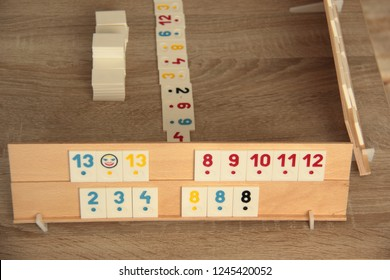 Wodden board with pieces of rummy game