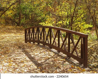 Woden bridge covered with leaves