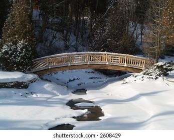 woden bridge on a frozen river