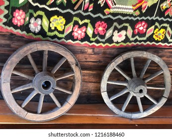 Woden old wheels with carpet decoration