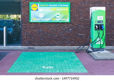 Woerden, Netherlands - SEPTEMBER 05 2019: Lidl has fast charging stations with green electricity from solar panels. Customers can charge their electric car there for free while shopping.