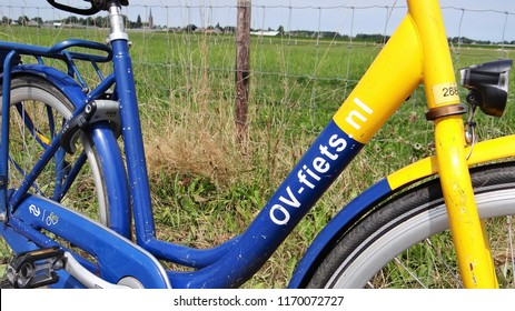 Wognum / Netherlands - July 6 2018: OV fiets rental yellow/blue bicycle of the Dutch railway corporation 'NS'