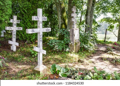 Wojnowo / Poland - 08.03.2018: Old russian Philippians cemetery in polish Masuria. Summer, sunny day. lake.